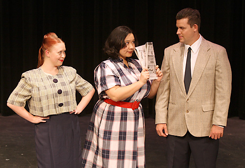 "Secretary Smitty (Eimi Taormina, center) tries encourage a romance between her friend Rosemary Pilkington (Kay Hight, left) and go-getter J. Pierrepont Finch (David Holmes, right) in DMTC's production of ""How to Succeed in Business Without Really Trying."" Fred Gladdis/Enterprise photo"