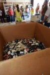 Floppy discs nearly fill a box at the landfill. The county's efforts to meet a state-mandated goal of  diverting 75 percent of trash by 2020 is on the right track. Sue Cockrell/Enterprise photo