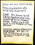 A student in Sarah Roche's class at Merryhill School explains the requirements the class met to have its wildlife habitat certified. Fred Gladdis/Enterprise photo