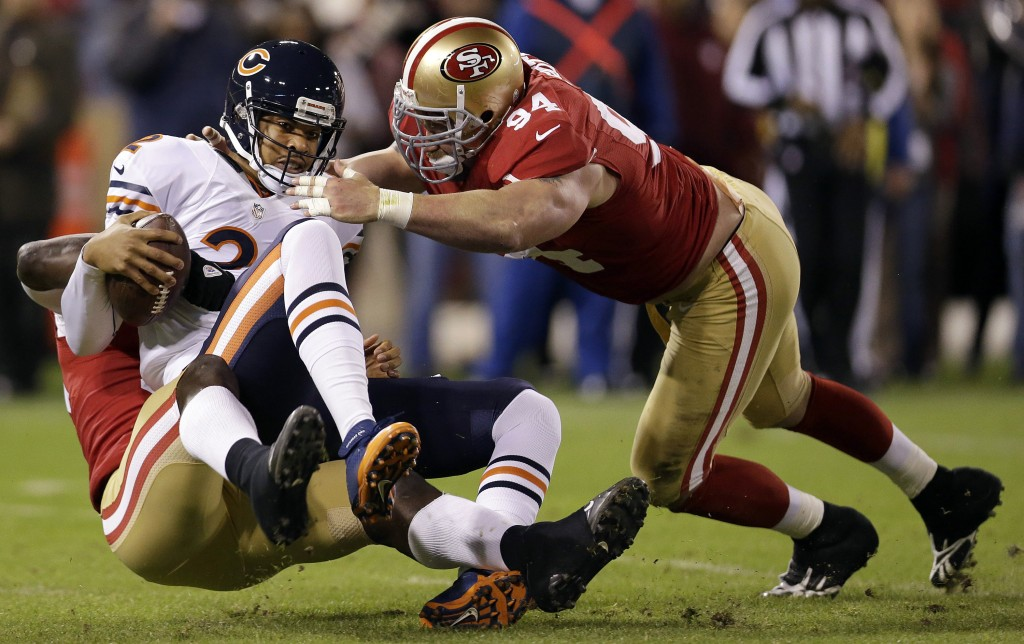 Chicago quarterback Jason Campbell (2) is sacked by San Francisco linebacker Aldon Smith, left, as defensive tackle Justin Smith (94) converges during the 49ers' 32-7 home win over the Bears on Monday. AP photo