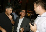 Alan Fernandes talks with John McGahan, right, and Matt Duffy at his celebration party Tuesday evening at Paisano's restaurant. Fred Gladddis/Enterprise photo