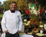 "Chef Andy Burtis, UC Davis Dining Services executive chef, hosted last year's Thanksgiving feast display at Davis Farmers Market. Burtis will prepare recipes from ""The Davis Farmers Market Cookbook"" for this year's display and tasting on Saturday at the market. Courtesy photo"