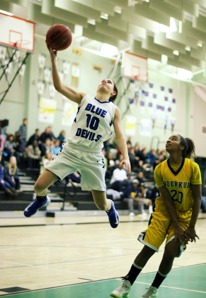 DHS senior Tori Powell shows off her athleticism on this shot in a game last week. Powell had six points on Thursday as the Lady Blue Devils blew out host Whitney, 69-27, in their final nonconference contest of the season. Wayne Tilcock/Enterprise file photo