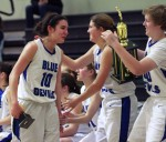 Members of the Lady Blue Devils — holding the championship trophy for winning the Dixon Ram Jam — greet senior Tori Powell after she received her all-tournament selection following the title game in December. DHS will look for the leadership of Powell and classmate Ashleigh Vandenbrink  in its key DVC game tonight at Monterey Trail. Wayne Tilcock/Enterprise file photo