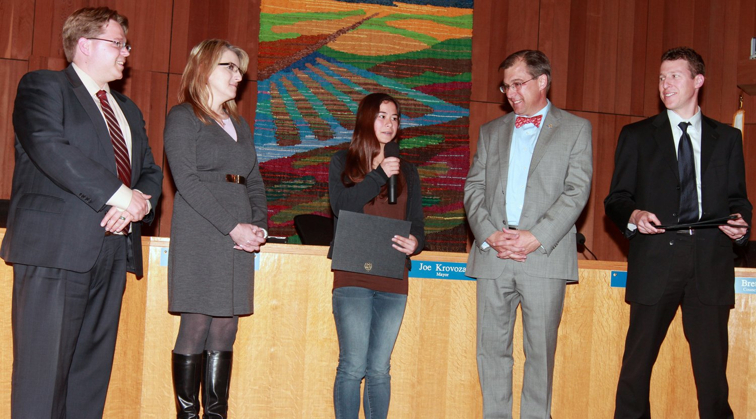 Michaela Saechow  receives her Golden Heart Award from  City Council members,  from left, Lucas Frerichs, Rochelle Swanson, Joe Krovoza and Dan Wolk.  Fred Gladdis/ Enterprise photos