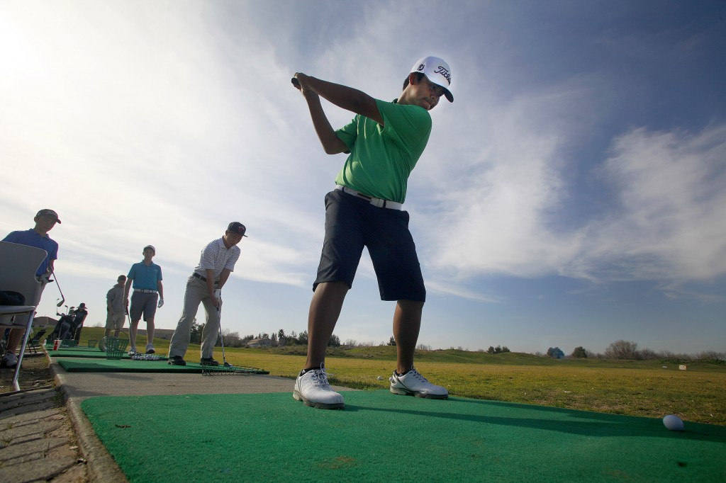 DHS junior Cyrrus Espino takes a swing on the driving range at Wildhorse during a practice last week. Wayne Tilcock/Enterprise photo