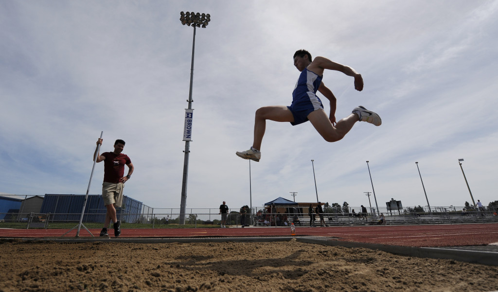 DHS' Victor Choi soars to an eighth-place finish in the long jump during Saturday's Halden Invitational at Ron & Mary Brown Stadium. Wayne Tilcock/Enterprise photo