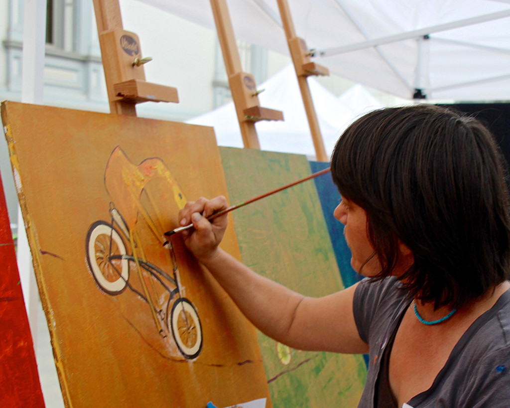 "Artist Danielle Fodor works on a mobile bike mural earlier this month at the Crocker Art Museum in Sacramento. She will lead the Davis ""Bike Fun"" mural project this summer. Courtesy photo"