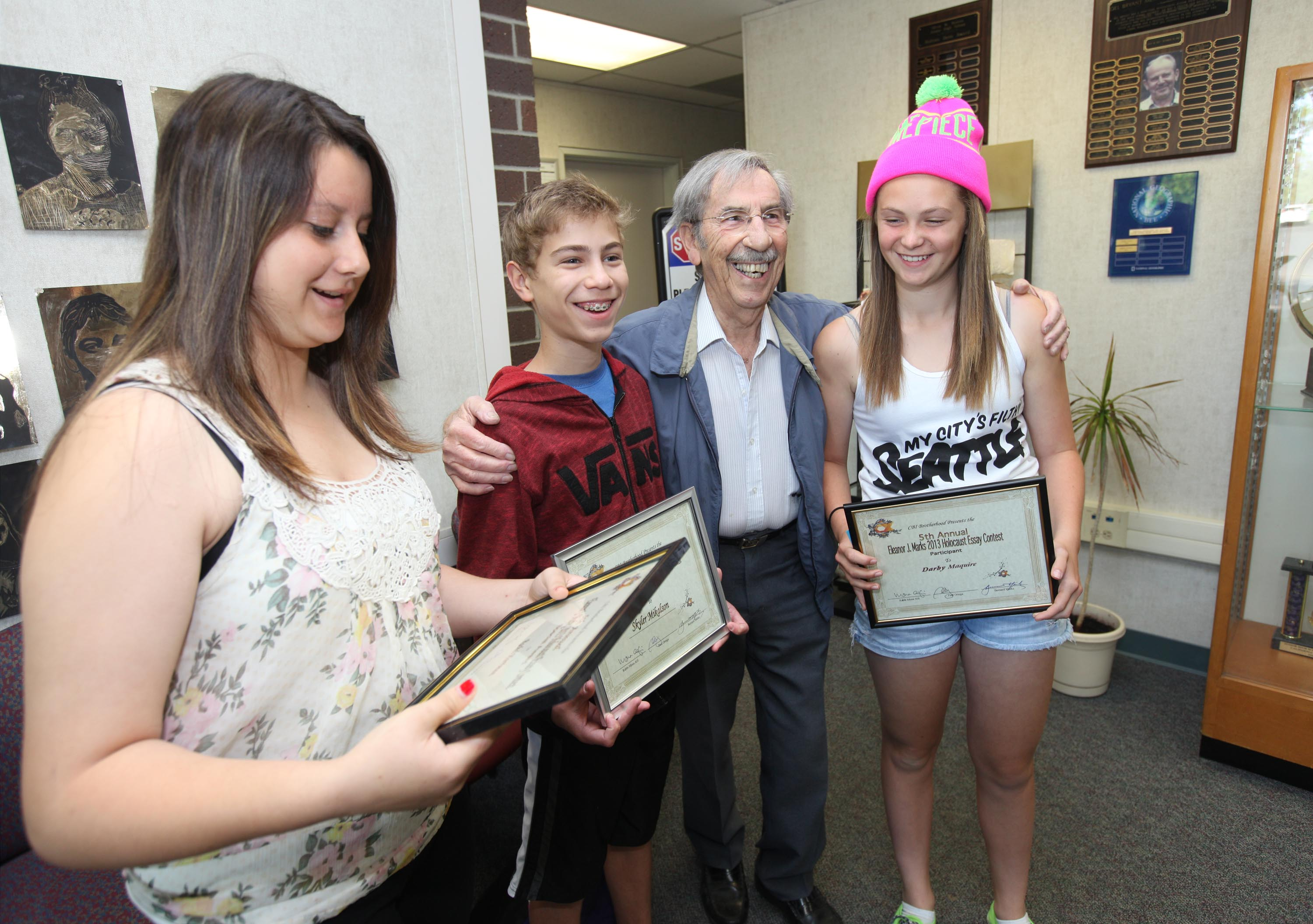 holmes students honored for holocaust essays holocaust survivor bernard marks of sacramento congratulates three holmes junior high school students for their winning essays in a contest he established
