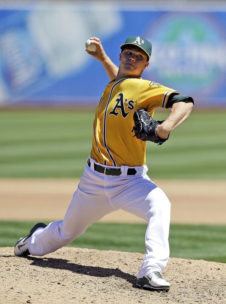 Oakland starting pitcher Sonny Gray throws to the Houston Astros on Thursday. Gray was brilliant in his home debut as the A's won 5-0. AP photo